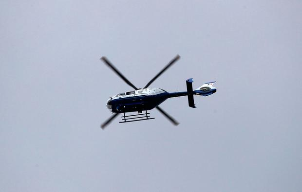The Garda helicopter hovers over the scene. Photo: Collins