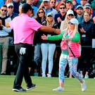 Patrick Reed and his wife Justine embrace on the 18th green at Augusta National. Photo: Getty Images
