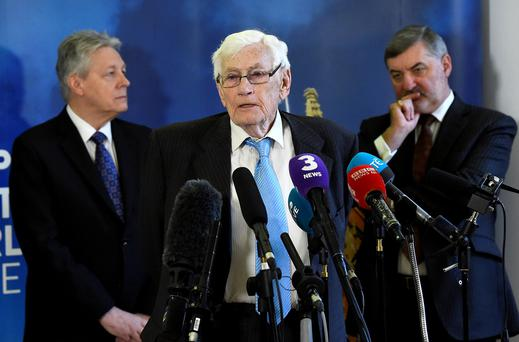 Seamus Mallon speaks as Peter Robinson and John Alderdice look on at an event to celebrate the 20th anniversary of the Good Friday Agreement, in Belfast, Northern Ireland, April 10, 2018. REUTERS/Clodagh Kilcoyne