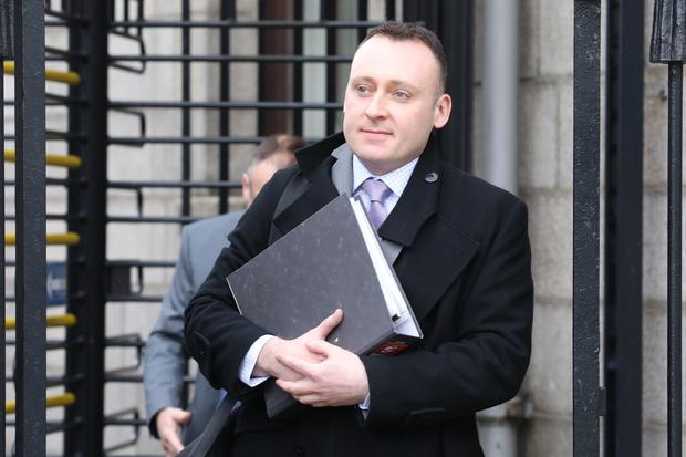 Declan O'Carolan, a detective garda, with an address in Skerries, Co. Dublin pictured leaving the Four Courts after his Circuit Civil Court action was dismissed. Pic: Collins Courts
