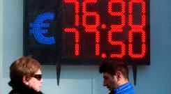 A board, showing the currency exchange rates of the US dollar and the Euro against the Russian rouble, is on display in a street in Moscow, Russia. Photo: Reuters