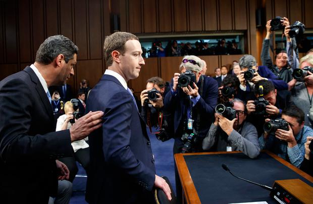 Facebook CEO Mark Zuckerberg arrives to testify before a joint hearing of the Commerce and Judiciary Committees on Capitol Hill in Washington, Tuesday, April 10, 2018, about the use of Facebook data to target American voters in the 2016 election. (AP Photo/Carolyn Kaster)
