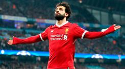 Liverpool's Mohamed Salah celebrates scoring his side's first goal of the game during the UEFA Champions League, Quarter Final at the Etihad Stadium