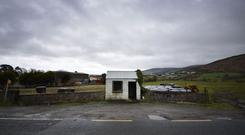 A disused customs guard hut directly situated on the north-south Irish border in Newry, Northern Ireland. Photo: Charles McQuillan/Getty Images