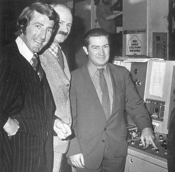 'Sunday World' founder Gerry McGuinness (left) as the first paper rolls off the press in 1973 watched by then editor Joe Kennedy (centre) and Minister for Industry and Commerce Justin Keating. Photo: Sunday World