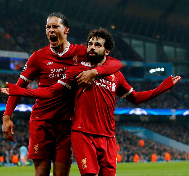 Liverpool's Mohamed Salah celebrates with Virgil van Dijk after puncturing Manchester City's comeback hopes at the Etihad last night. Photo: Andrew Yates/Reuters