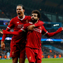 Liverpool's Mohamed Salah celebrates with Virgil van Dijk