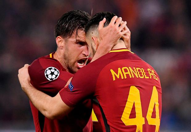 Roma's Konstantinos Manolas celebrates with Kevin Strootman at the end of the match. Photo: Alberto Lingria/Reuters