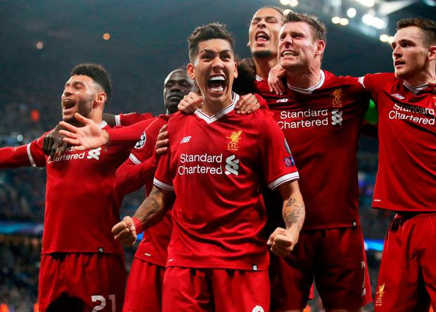 Liverpool's Roberto Firmino celebrates with his team mates. Photo: Nick Potts/PA Wire