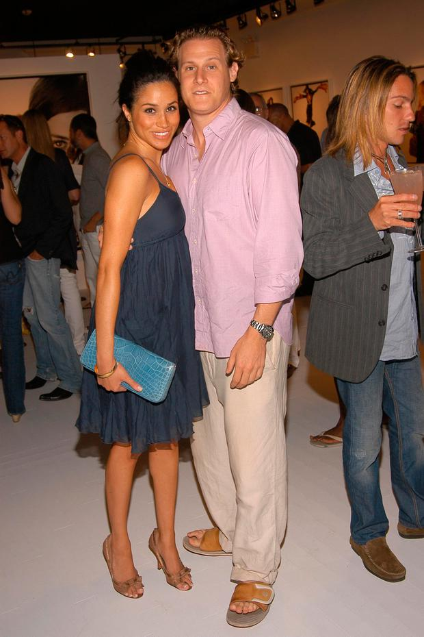 Meghan Markle and Trevor Engelson attend COACH Legacy Photo Exhibit by REED KRAKOFF at Coach on August 26, 2006 in East Hampton, NY. (Photo by Billy Farrell/Patrick McMullan via Getty Images)