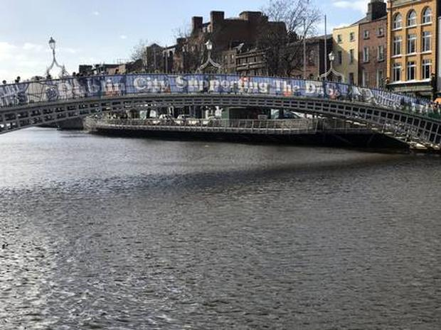 Banners placed on the Ha'penny Bridge celebrating Dublin GAA have been branded cheap and tacky. Pic Collins Photos