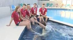 Mike Bushell gets a little wet during an interview with UK swimmers