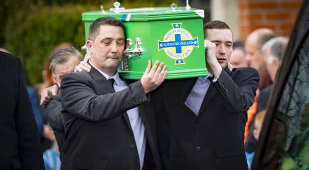 Stuart Carson carrying Carter's coffin