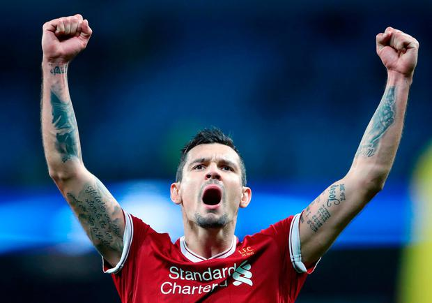 Liverpool's Dejan Lovren celebrates victory after the UEFA Champions League, Quarter Final at the Etihad Stadium, Manchester. PRESS ASSOCIATION Photo. Picture date: Tuesday April 10, 2018. Nick Potts/PA Wire