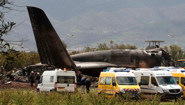 Firefighters and civil security officers work at the scene of a fatal military plane crash in Boufarik, near the Algerian capital, Algiers, Wednesday, April 11, 2018. Algerian emergency services say 181 people have been killed in a military plane crash and some survivors have been rescued. (AP Photo/Anis Belghoul)