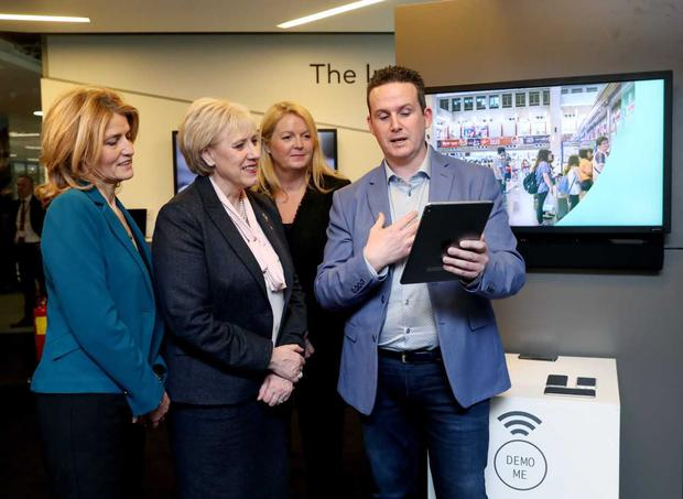 Heather Humphreys TD tests news payment innovations at Mastercard's Leopardstown office, as the company announces 175 new jobs in Ireland.