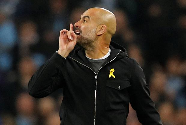 Manchester City manager Pep Guardiola gestures to referee Antonio Miguel Mateu Lahoz
