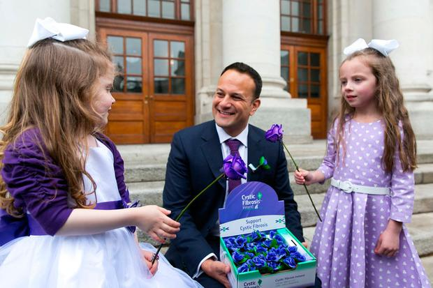 Countdown to Cystic Fibrosis Ireland's 65 Roses Day Pictured is An Taoiseach, Leo Varadkar TD with Eva Rose Martin, age 5, from St Margaret's, Dublin, who has cystic fibrosis and Ciara Moore, age 6, from Ashbourne, Co. Meath (Eva Rose's best friend). Picture by Shane O'Neill, SON Photographic