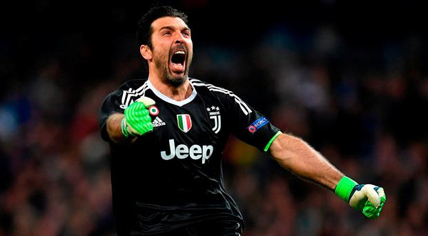 MADRID, SPAIN - APRIL 11: Gianluigi Buffon of Juventus celebrates after his sides third goal during the UEFA Champions League Quarter Final Second Leg match between Real Madrid and Juventus at Estadio Santiago Bernabeu on April 11, 2018 in Madrid, Spain. (Photo by Matthias Hangst/Bongarts/Getty Images)