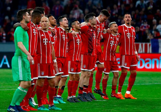Bayern players celebrate after advancing to the semifinal after the Champions League quarter final second leg soccer match between FC Bayern Munich and Sevilla FC at the Allianz Arena stadium in Munich, Germany, Wednesday, April 11, 2018. (AP Photo/Matthias Schrader)