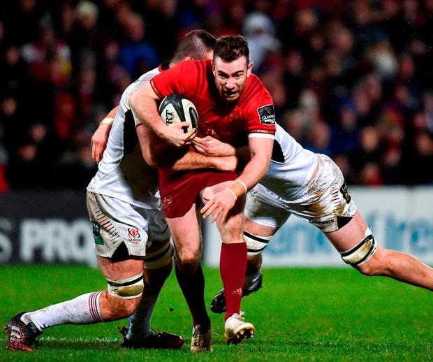Munster's Duncan Williams is tackled by Ulster's Alan O'Connor (L) and Nick Timoney. Both teams have plenty to play for over the last two weeks of the PRO14's regular season. Photo: David Fitzgerald / Sportsfile