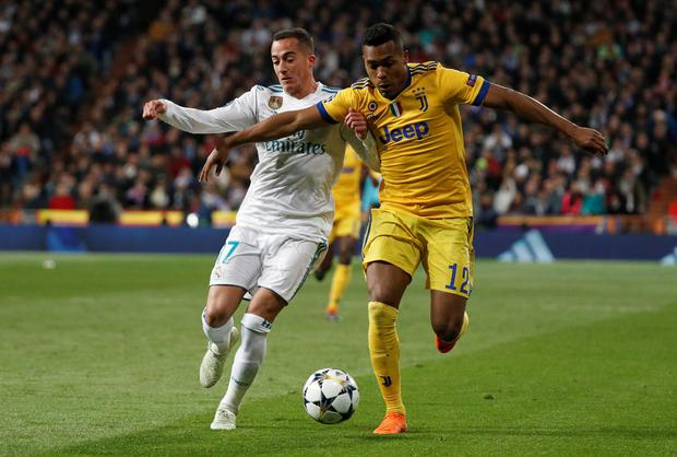 Real Madrid's Lucas Vazquez tries to challenge Juventus' Alex Sandro