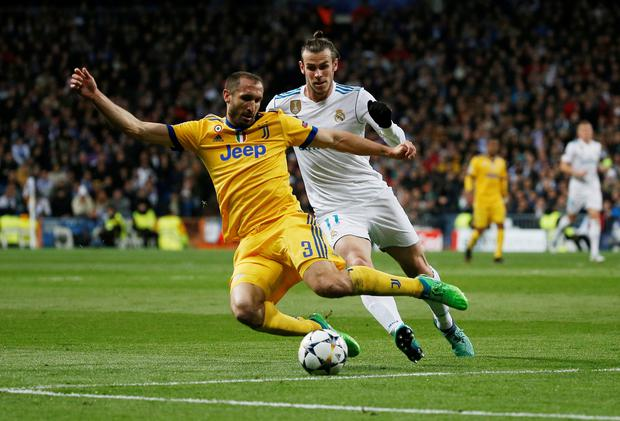 Juventus' Giorgio Chiellini battles for the ball with Real Madrid's Gareth Bale. Photo: Reuters