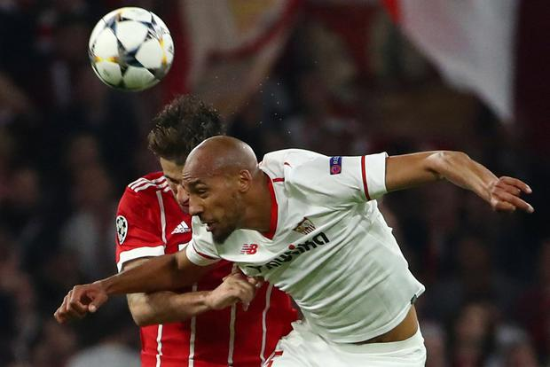 Sevilla's Steven N'Zonzi is first to the ball. Photo: Reuters