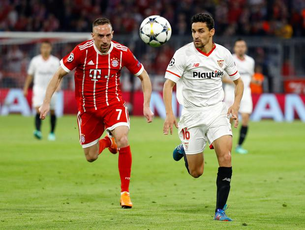 Sevilla's Jesus Navas in action with Bayern Munich's Franck Ribery. Photo: Reuters