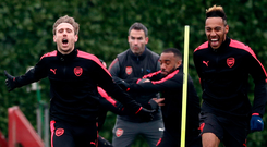 Arsenal duo Nacho Monreal and Pierre-Emerick Aubameyang are all smiles during training yesterday in London. Photo: PA