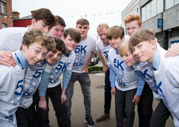 Leinster's Garry Ringrose and coach Leo Cullen help students launch the Blackrock College 5K Rock Run. Photo: Colin O'Riordan