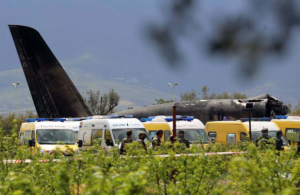 An Algerian military plane is seen after crashing near an airport outside the capital Algiers. Photo: Reuters