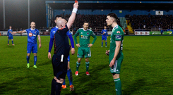 Garry Buckley of Cork City is shown a red card by referee Robert Rogers