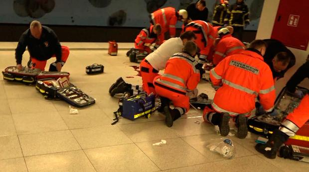 Firefighters treat an injured person at a subway station in Hamburg, Germany, Thursday, April 12, 2018. Police say a woman and her child have died after being stabbed by her ex-husband at a subway station in central Hamburg. The knife attack happened Thursday morning at the Jungfernstieg station in GermanyÕs second-biggest city. (Tnn/dpa via AP)