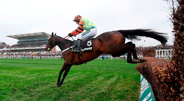 Might Bite ridden by Nico de Boinville jumps the last prior to winning the Betway Bowl Chase during day one of the 2018 Randox Health Grand National Festival at Aintree