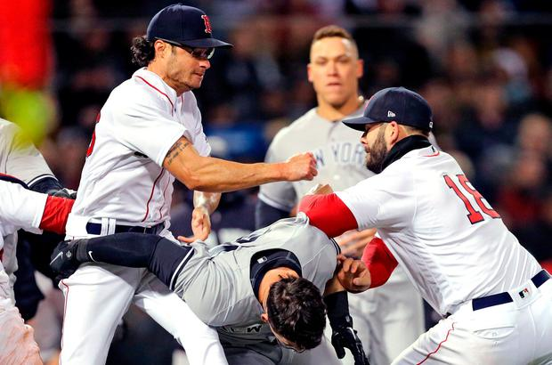 Mitch Moreland #18 of the Boston Red Sox, right, works to separate Joe Kelly #56 and Tyler Austin #26 of the New York Yankees during the seventh inning at Fenway Park on April 11, 2018 in Boston, Massachusetts. Austin rushed the mound after being struck by a pitch from Kelly. (Photo by Maddie Meyer/Getty Images) ***BESTPIX***