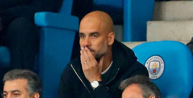 Manchester City manager Pep Guardiola sat in the stands Action Images via Reuters/Jason Cairnduff