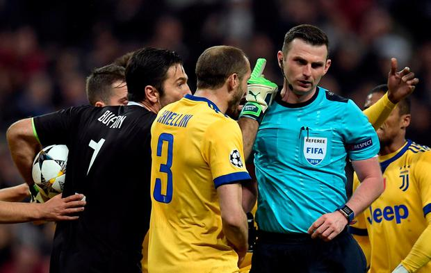 Juventus' Italian goalkeeper Gianluigi Buffon (L) argues with the referee during the UEFA Champions League quarter-final second leg football match between Real Madrid CF and Juventus FC at the Santiago Bernabeu stadium in Madrid on April 11, 2018. / AFP PHOTO / OSCAR DEL POZOOSCAR DEL POZO/AFP/Getty Images