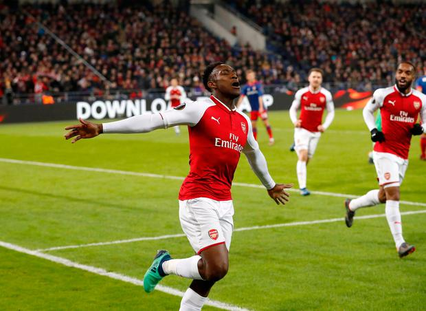 Danny Welbeck celebrates after scoring Arsenal's opening goal. (AP Photo/Pavel Golovkin)