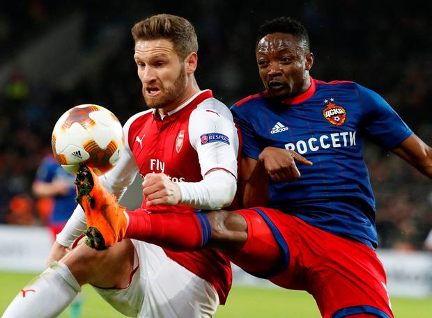 CSKA Moscow's Ahmed Musa and Arsenal's Shkodran Mustafi battle for possession. Photo: REUTERS/Grigory Dukor