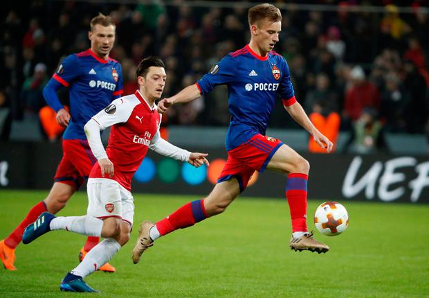 CSKA Moscow's Konstantin Kuchaev skips past Mesut Ozil. Photo: REUTERS/Grigory Dukor
