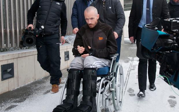 Murderer Keith Lee leaves the Criminal Courts of Justice in a wheelchair having jumped from a third-floor balcony. Photo: Gareth Chaney