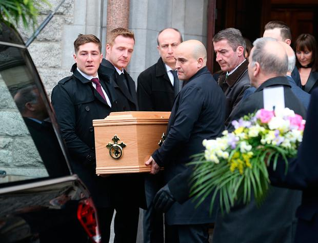Gerry McGuinness's coffin is carried from the church Photo: Damien Eagers and 'Sunday World'