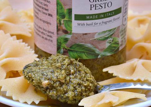 A spoon of a supermarket own-brand Italian green pesto sauce. A Which? investigation of 12 own-brand standard and premium pestos, all made in Italy and sold by UK supermarkets, found that they contained a range of substitute and often cheaper ingredients such as sunflower oil, carrot and even bamboo fibres, in addition to the sauce's traditional four key ingredients of basil, pine nuts, parmesan and olive oil. Photo: Nick Ansell/PA Wire