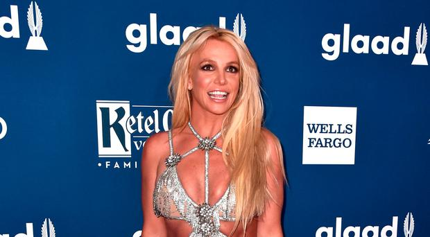 Britney Spears announces 'indefinite work hiatus' to care for her father as he recovers from life-threatening illness