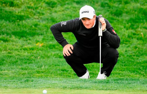 Paul Dunne of Ireland lines up his putt on the 8th green during day two of the Open de Espana at Centro Nacional de Golf on April 13, 2018 in Madrid, Spain. (Photo by Ross Kinnaird/Getty Images)