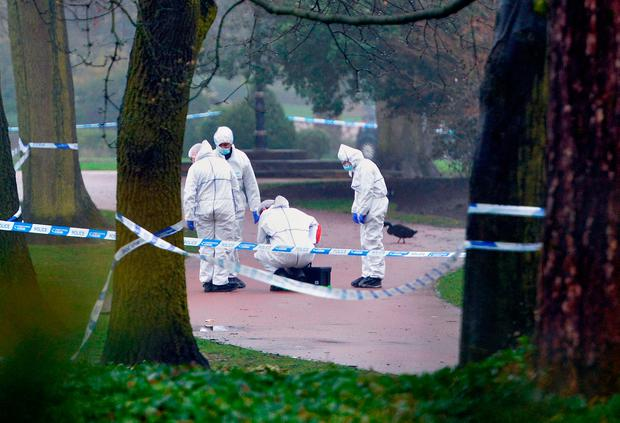 Police at the scene after a girl's body was found in West Park, Wolverhampton. PA Wire