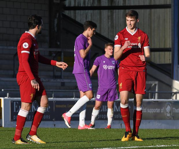 Conor Masterson (right) of Liverpool celebrates