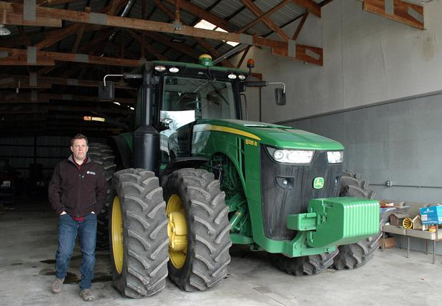 Illinois grain farmer Lucas Strom checks on his tractor inside his barn in unincorporated Kane County, Illinois, U.S., April 10, 2018. Strom had planned to purchase a grain storage bin, but changed his mind when the price increased after the announcement of steel tariffs by the Trump administration last month. Picture taken April 10, 2018. REUTERS/P.J. Huffstutter