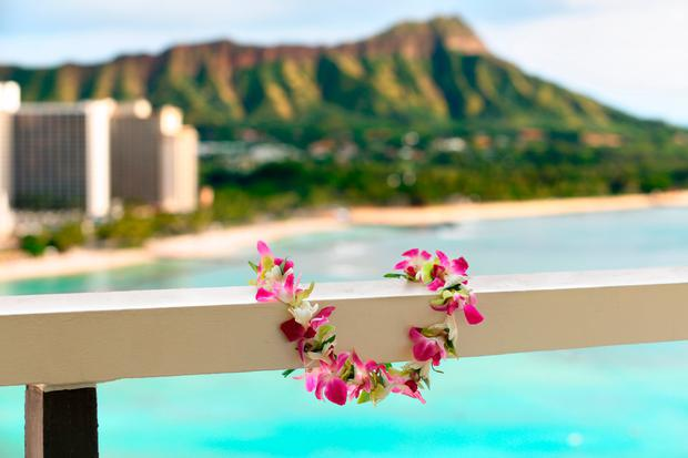 Hawaii travel icon: Lei flower necklace in front of Waikiki beach